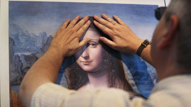 España: 'La Gioconda' en la palma de la mano